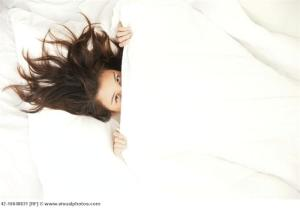 Woman Hiding Under the Covers