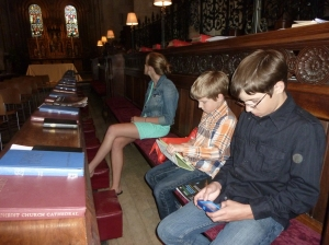 winter kids in church texting